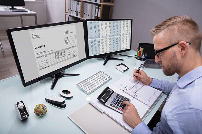 Finance staff working at computer