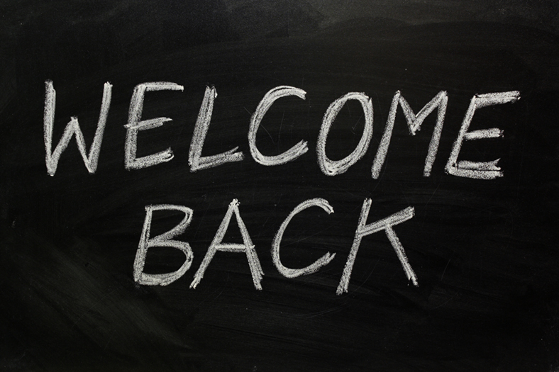 Welcome back written on blackboard