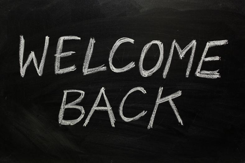 Welcome back written on blackboard